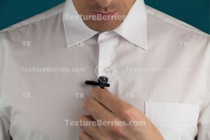 A man fixes lavalier microphone, preparation for interview