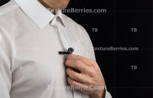 A man puts on lavalier microphone, preparation for interview