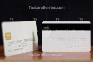 Backside and front side of white credit card with embossing