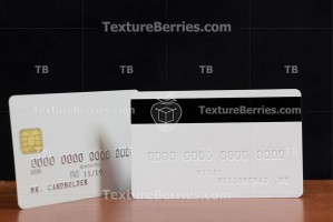 Backside, front side of white credit card with embossing