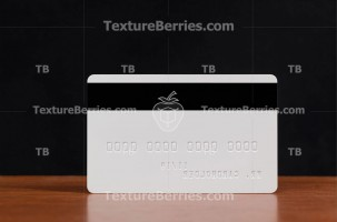 Backside of white credit card with embossing
