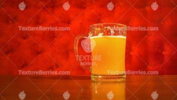 Beer mug over red velvet background, restaurant