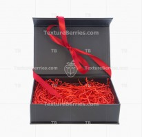 Black box with red filler and bow isolated on white