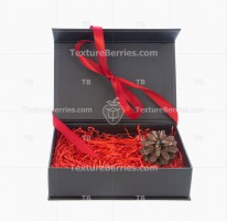 Black box with red filler, bow and cone isolated on white