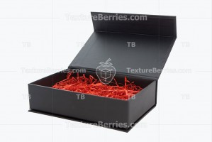Black gift box with red filler isolated on white background
