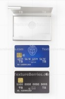 Blank blue and black credit cards and metal business card holder