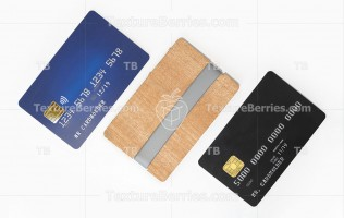 Blank blue and black credit cards and stylish wooden card holder