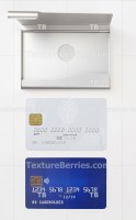 Blank blue and white credit cards and metal business card holder
