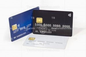 Blue, white and black credit cards on white background