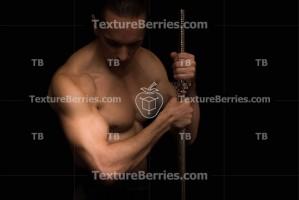 Bodybuilder with barbell on black background, bodybuilding concept