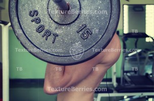 Closeup portrait of bodybuilder workout with barbell