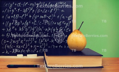 Concept of education, school books in front of the blackboard