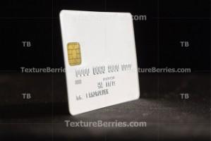 Credit card on dark background, side view