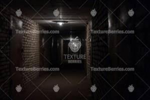 Dark long corridor in the basement