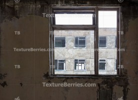 Dead city inside, view to abandoned building from window