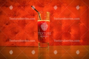 Fresh red juice on red background