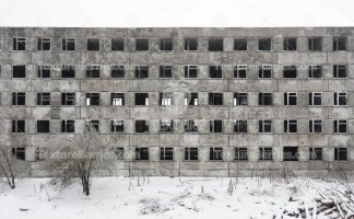 Front facade of abandoned building in dead city