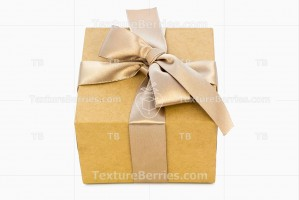 Gift box with golden ribbon isolated on white