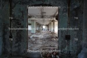 Inside destroyed building, long corridor