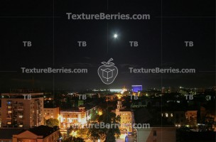Krasnodar, Russia, at night with moon in the sky