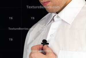Man holds lavalier microphone, preparation for interview