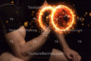 Man with burning dumbbell on black background, bodybuilding concept