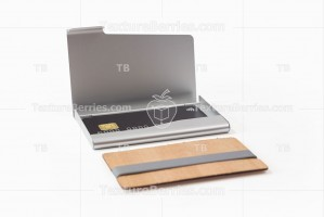 Metal and wooden business card holders with black credit card