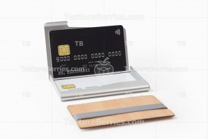 Metal and wooden business card holders with credit cards
