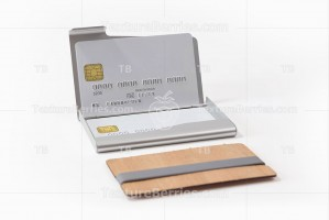 Metal and wooden business card holders with white credit cards