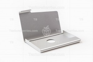 Metal business card holder on white background