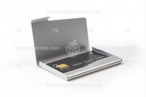 Metal business card holder with black credit card