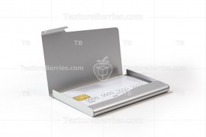 Metal business card holder with white credit card