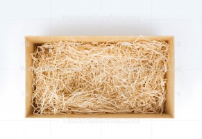 Open gift box with decorative straw, top view