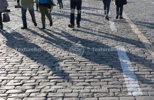 Pedestrians on cobblestone pavement, people traffic, city concept