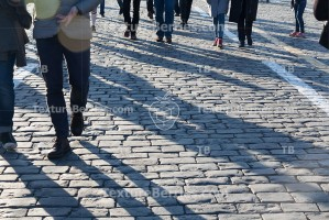 Pedestrians on cobblestone pavement, people traffic