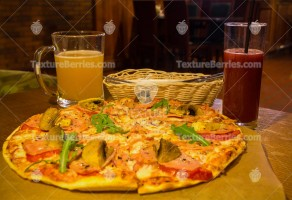 Pizza with champignons and drinks, restaurant background
