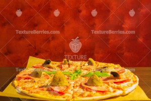 Pizza with champignons on the table over red velvet background