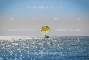 Positive leisure activities, yellow parachute with smile