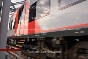 Rapid train passing bridge, motion blur, closeup