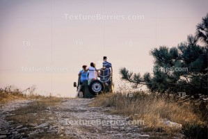 Rear view of a blurred group of tourists in jeep on safari