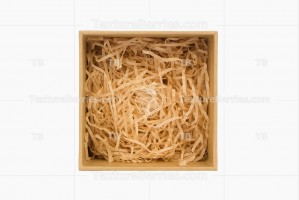 Square gift box with natural filler isolated on white