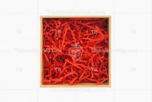 Square gift box with red filler isolated on white