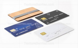 Three blank credit cards and stylish wooden card holder