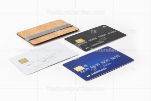 Three blank credit cards and wooden card holder
