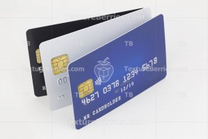 Three credit cards blue, white and black on white background