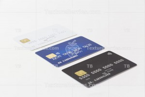 Three credit cards in the row on white background