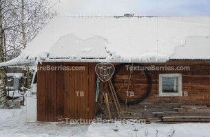 Traditional wooden rustic barn in winter, closeup