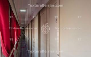 Train interior, long corridor and many doors