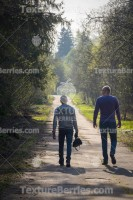 Two friends walk in the park, big and small concept