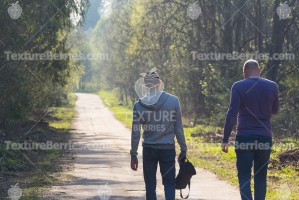 Two men on walk, big and small concept